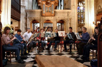 Picture of Wendy Marks leading the Oxford Sinfonia Wind Octet on the oboe in St Mary's Church Oxford